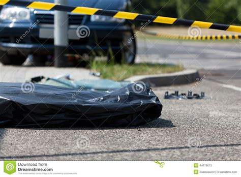 Cadavre Bag corpse in plastic bag after car stock image