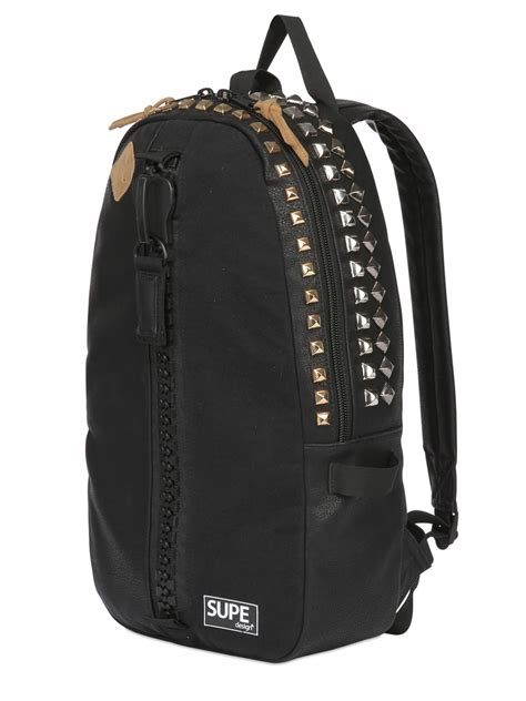 studded faux leather backpack lyst supe design studded faux leather backpack in black
