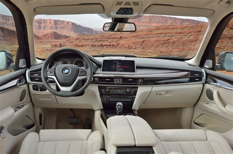 inside bmw 2014 bmw x5 first look motor trend
