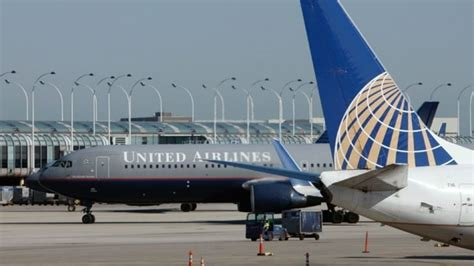 united airlines ticket change fee united and us airways raise ticket change fee to 200