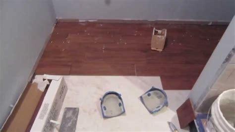 install  wood  porcelain plank tile floor
