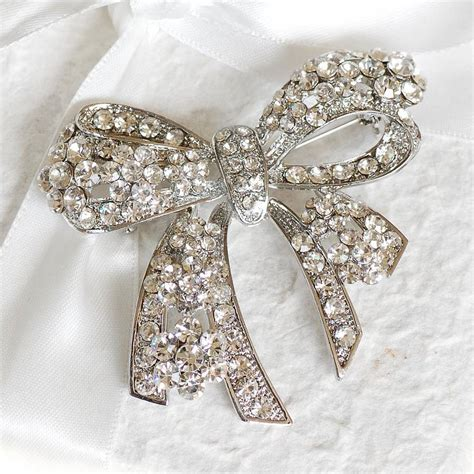 jrhz148 antique style silver brooch necklace blue white vintage style bow brooch by highland notonthehighstreet