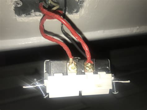electrical light switch with 2 black wires and one red