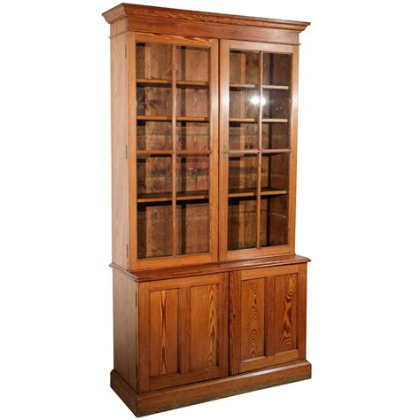 glass front pine cabinet and bookcase at 1stdibs