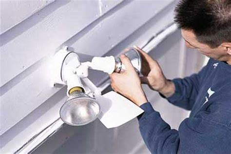 Installing Garage Lights by How To Install A Garage Floodlight This House