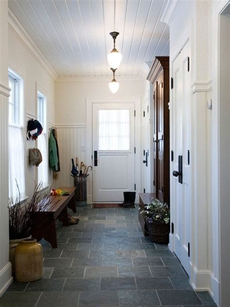 mudroom tile mud room entry beadboard on walls and ceiling slate