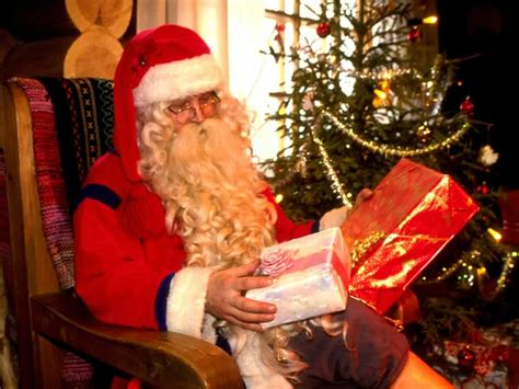 santa looking at presents father christmas pinterest