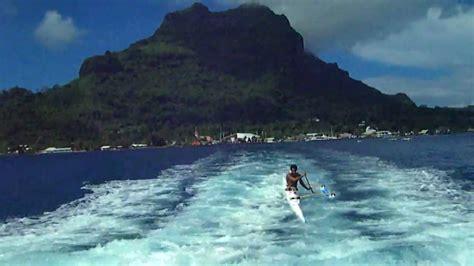 canoe boat wake outrigger canoe in tahiti rides boat wake and flips kayak
