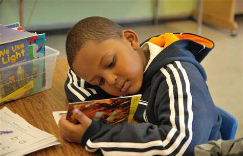 picture of a child reading a book literacy for all must stand at the of new