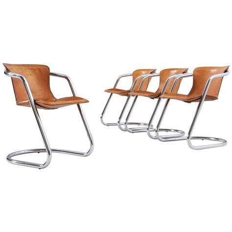 Tubular Dining Chairs Willy Rizzo Set Of Four Tubular Dining Chairs In Cognac Leather For Sale At 1stdibs
