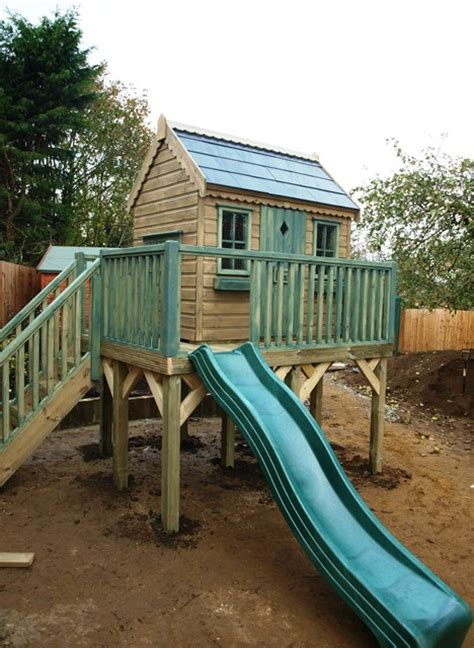 tree house slide treehouse with slide treehouses the playhouse company