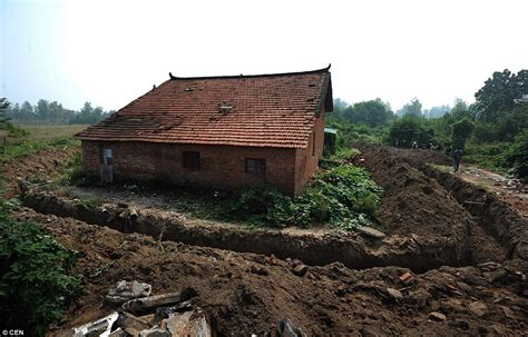 Build A House Online chinese developers a 1 5 metre trench around couple s farm