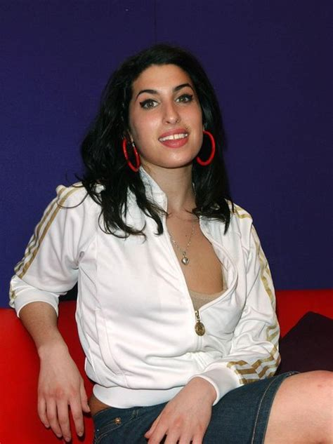Winehouses Scarlet Nose Hints That Recent Troubles Are Taking Their Toll by Winehouse Winehouse In Photographs