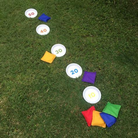 backyard bean bag toss game outdoor games diy bean bag toss mod podge rocks