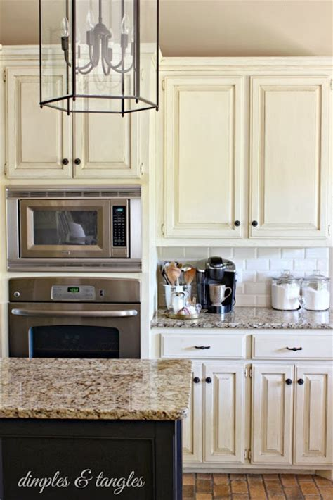 cream colored painted kitchen cabinets cream colored cabinets white subway tile backsplash