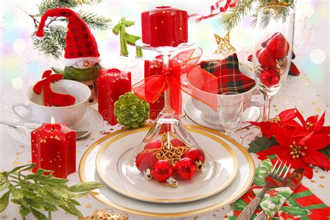christmas table decoration with red candles stock image