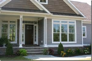 Bungalow Vs Ranch craftsman dining room grey house with stone vinyl siding
