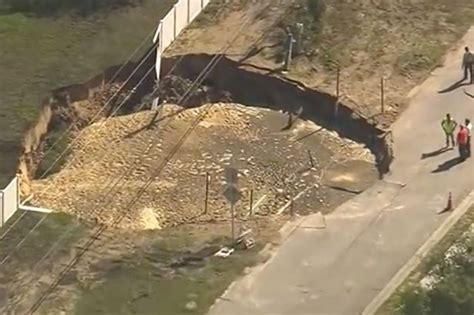 is florida going to sink sinkhole forces residents to flee homes as