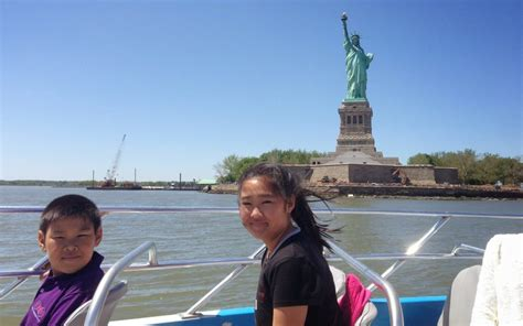speed boat around statue of liberty 5 day nyc itinerary things to do in nyc hilton mom voyage