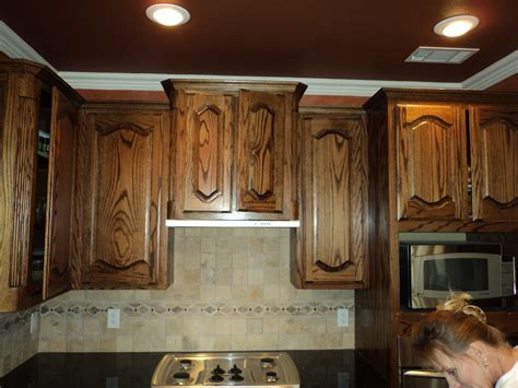 painting stained oak kitchen cabinets staining oak cabinets dark brown