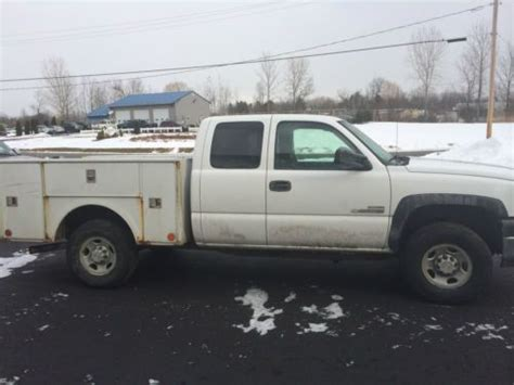 sell used 2006 chevy silverado work truck ext cab longbed tow 55k texas direct auto in stafford sell used 2006 chevrolet silverado 2500 hd wt extended cab