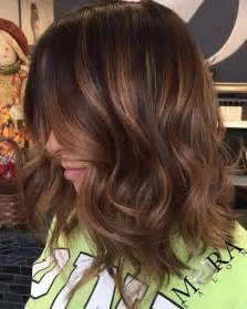 highlights for black hair and layered for 50 60 looks with caramel highlights on brown and dark brown hair
