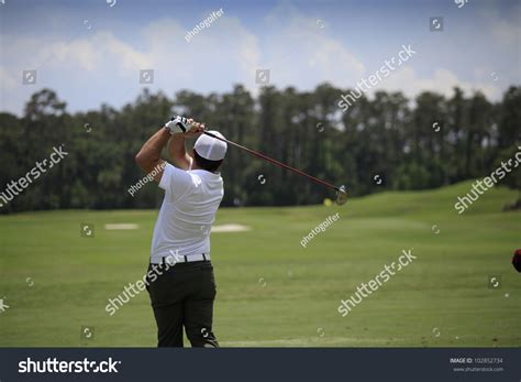 swing man golf man golf swing stock photo 102852734 shutterstock
