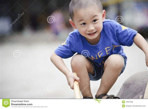 cute teen boy stock photos pictures royalty free cute cute little asian boy squatting stock photo image 16037208