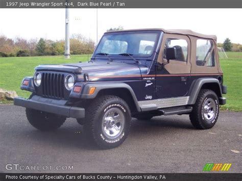 dark blue jeep dark blue pearl 1997 jeep wrangler sport 4x4 tan