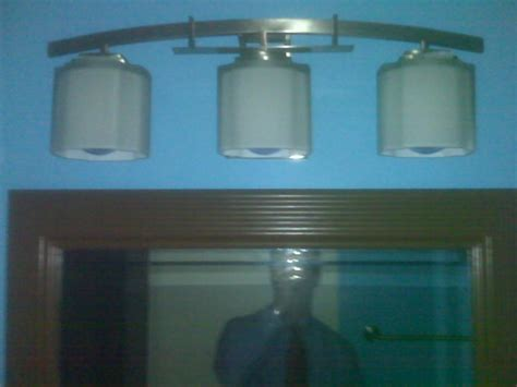 installing bathroom light fixture over mirror bathroom vanity lights home depot shanti designs