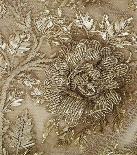 beadwork on fabric of sweat beading and sequin work threading