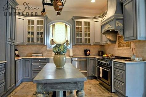 painting kitchen cabinets with annie sloan annie sloan chalk paint kitchen cabinets paintbrush and