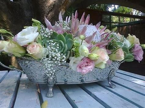 Lisianthus, roses, pink protea, succulents, baby's breath