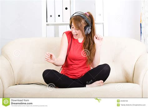 teen on couch beautiful teenage girl listening to music stock photo