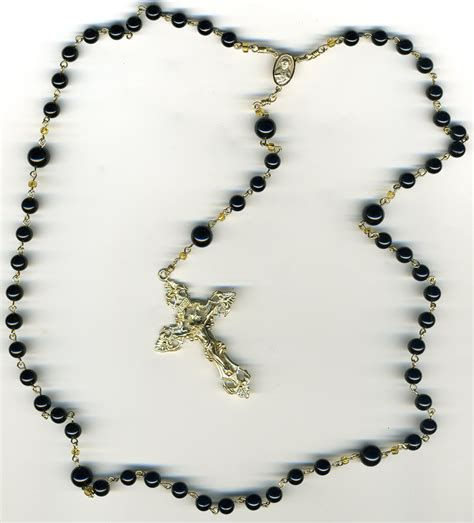 how many does a rosary cross don and his spiritual journey