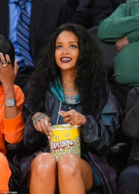 rihanna hairstyles games rihanna sips on beer as she shows off her legs at a lakers