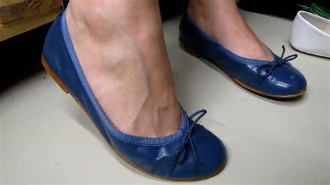 dangling flat shoes dangling in blue ballerina flats