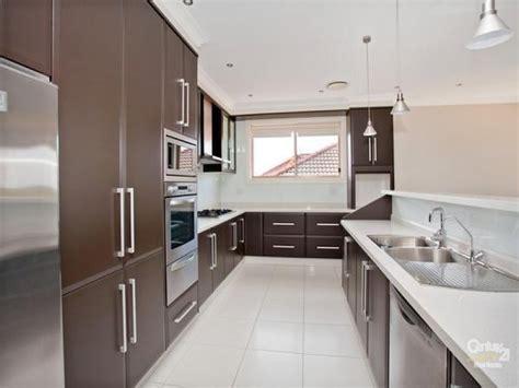 kitchen design sles modern island kitchen design using stainless steel