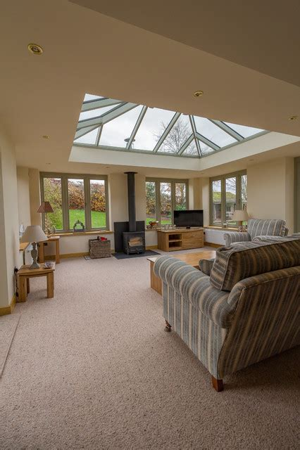 living room extension cost linked living room orangery style with woodburner modern conservatory west midlands by