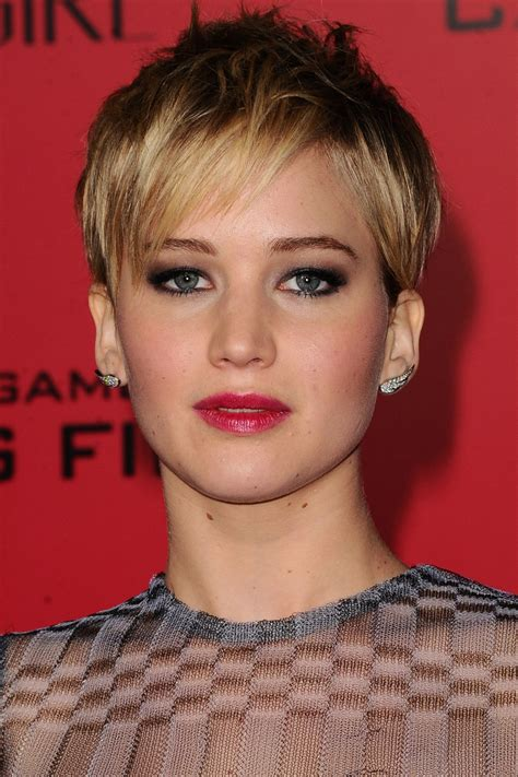 is jennifer lawrence hair cut above ears or just tucked behind jennifer lawrence s hair looks every gorgeous style look