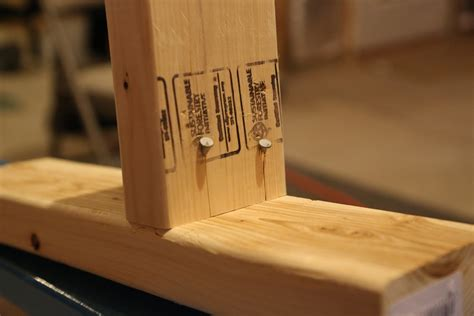 stick frames to wall framing do the nails stick out at all when toe nailing