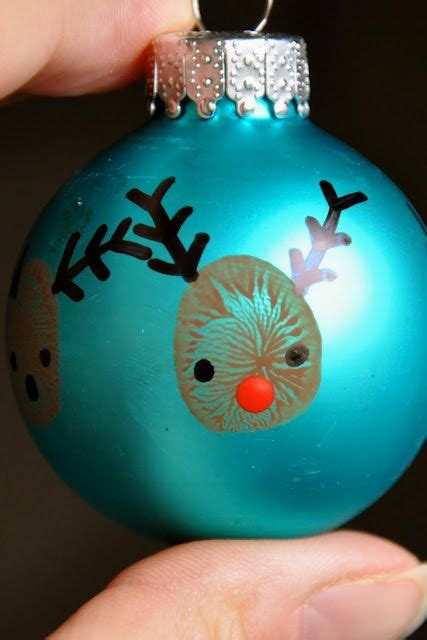 kids thumbprint reindeer ornaments this makes me want to