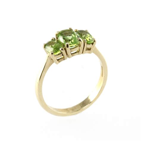 9ct yellow gold oval 3 peridot ring from mr