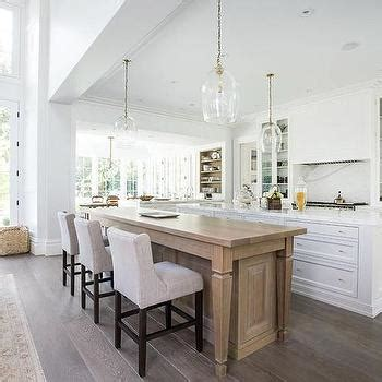 kitchen island with dining table kitchen island dining table with gray tufted dining chairs