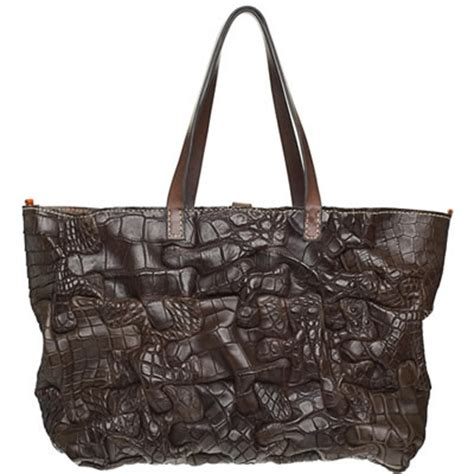 Henry Cuir Chateau Bag by Sheryl Style Henry Cuir Puzzle Tote Purseblog