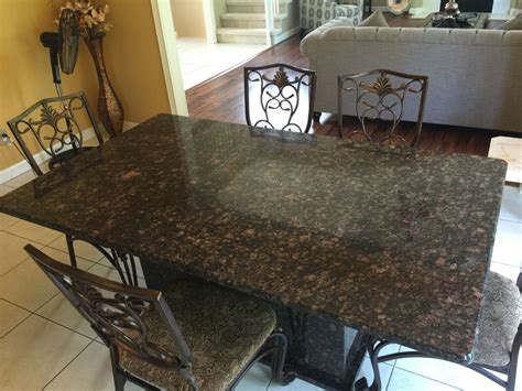 typhone boaurdoux exotic granite table with granite bases granite table with granite base hesano brothers