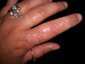 white ink flower tattoo on finger tattoobite com