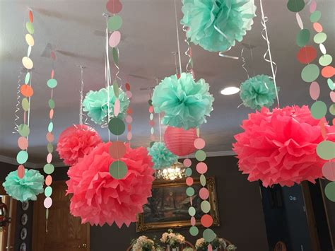 baby shower decorations mint and coral pom pons hanging from the ceiling talent show ideas