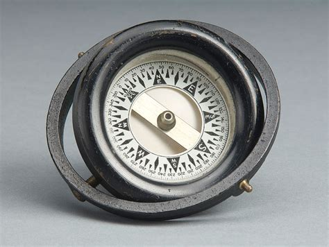 old boat compass on the water boat compass