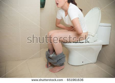 stomach pain after using bathroom beautiful elegant girl feeling stomach ache stock photo